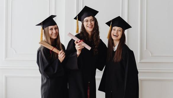 three female college graduates